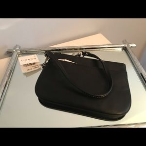Coach - black leather wristlet with silver accents